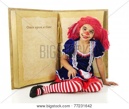 "A young elementary ""rag doll"" happily sitting before a huge opened book to a page with the words ""Once upon a time"".  The rest of the page is left blank for your text.  On a white background. poster"