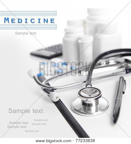 Stethoscope and other things on light background