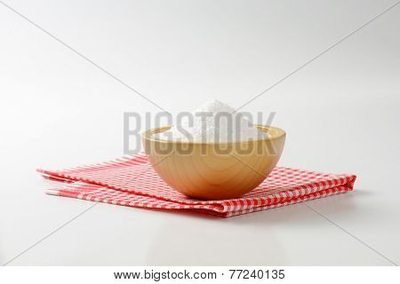 heap of salt in the wooden salt cellar on the fabric linen poster