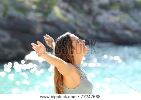 Happy Woman Breathing Fresh Air Raising Arms On Holidays