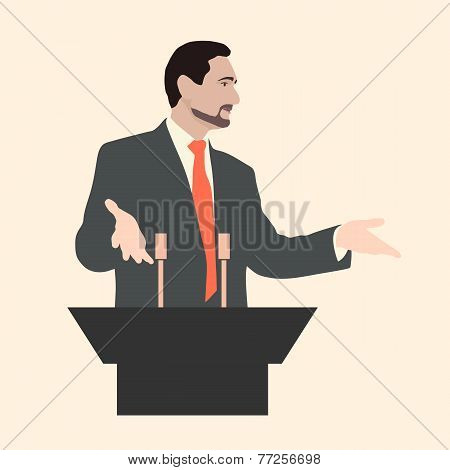Orator stands behind a podium with microphones