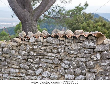 Drystone wall and roof tiles