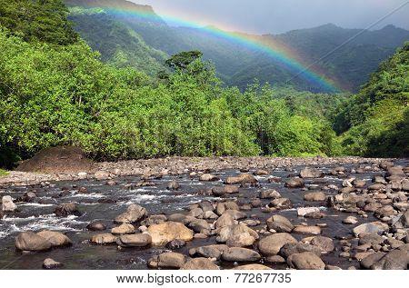 Tahiti. Polynesia. Mountain river and rainbow