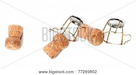 Corks from champagne wine and muselets isolated on white background poster
