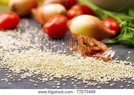Close up of quinoa grains cherry tomato, onion and parsley
