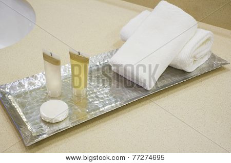 Shower set at hotel, A bar of soap, with hand towels and wash cloths, shampoo and body lotion