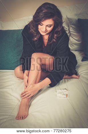 Woman applying moisturiser cream on her legs