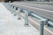 Anodized safety steel barrier on freeway bridge poster