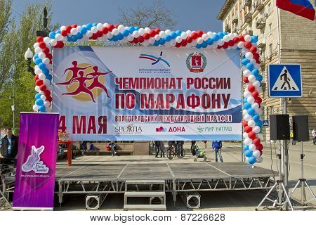 Podium for the winners of the Volgograd marathon with the official symbols