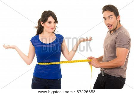 handsome astonished man holding measuring tape around thin fit young girl's waist concept of dieting fitness weightloss  isolated on white poster