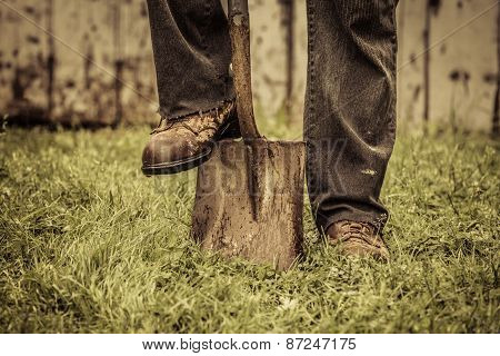 Details of feet and Shovel in front of Barn poster