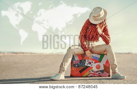 Traveler Woman Sits On Suitcase