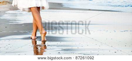 Woman walking on sand beach