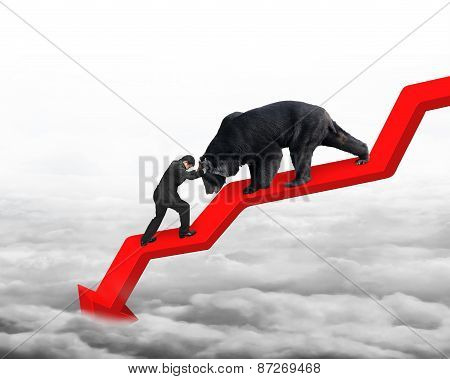 Businessman Against Bear On Arrow Downward Trend Line With Cloudscape