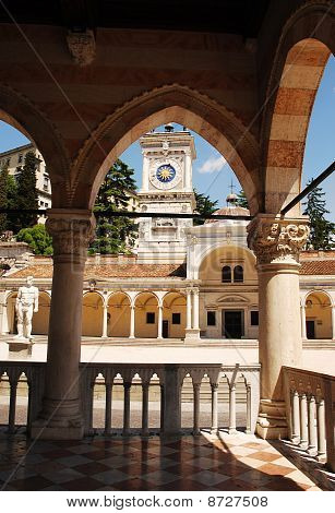 The 16th century Renaissance Loggia di San Giovanni in Piazza della Liberta in Udine Italy designed by Bernardo Da Morcote as seen from the portico of the 15th century Loggia del Lionello which was built between 1448 and 1457 in Venetian-Gothic style and poster