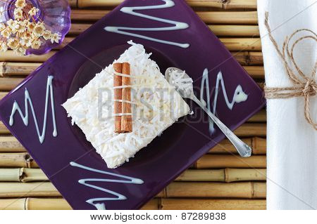 Rice Pudding  With Coconut, Condensed Milk And Cinnamon On Purple Plate