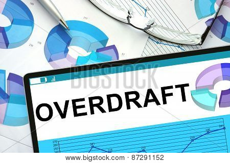 Overdraft on tablet with graphs.