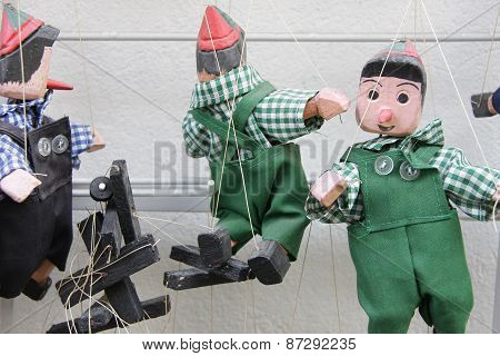 Pinnochio Puppets On A String