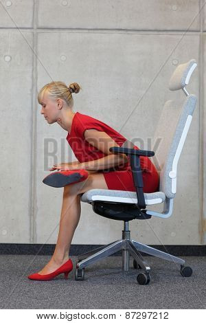 Stock Photo: break at work in office - relax on chair - business woman exercising