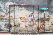 GEORGE TOWNPENANG MALAYSIA- CIRCA March 26 2015: Public street Old with realistic Children on the Swing at Step by Step Lane in George Town Malaysia poster