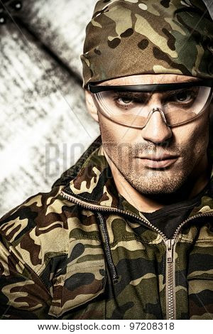 Masculine soldier in camouflage. Military, war.