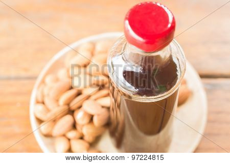 Bottle Of Black Iced Coffee With Almond Grain
