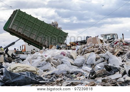 Garbage Truck Unloading Garbage At Dumping Ground