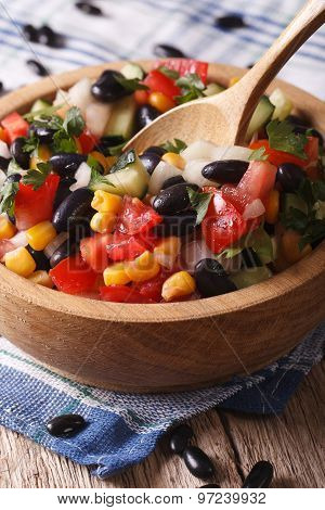 Salad With Black Beans, Avocado, Corn And Tomatoes Closeup Vertical