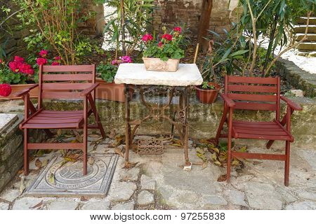 Chairs and table on the backyard of an istrian house in Croatia.