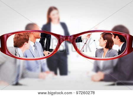 Glasses against assertive businesswoman giving a presentation