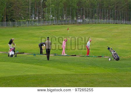 Golf players.