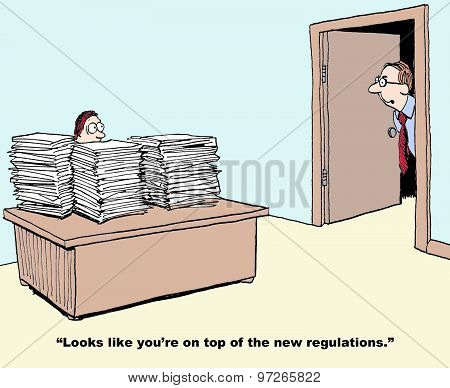 "Business cartoon showing a manager with their desk piled up with papers.  Businessman looks in and says, ""Looks like you're on top of the new regulations"". poster"