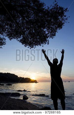 Man Saluting Sun At Adriatic Sea