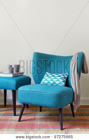 Teal retro armchair and ottoman vertical