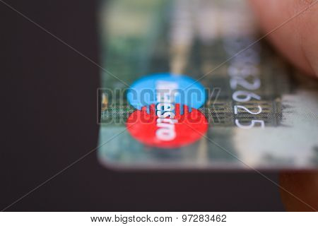 Man Holding Maestro Bank Credit Cards.