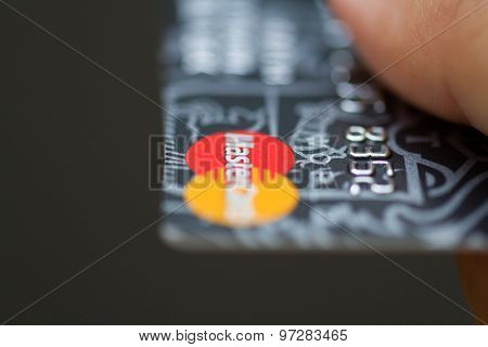 Man Holding Mastercard Bank Credit Cards.