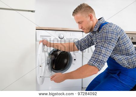 Technician Fixing Washing Machine