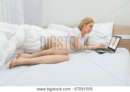 Woman Videoconferencing With Man On Laptop
