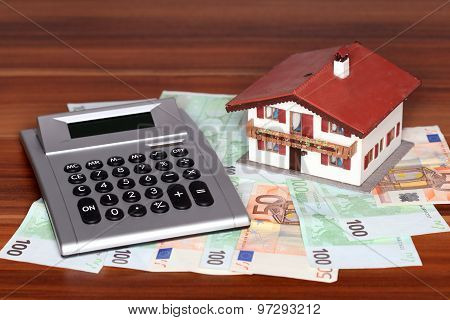 Banknotes And House