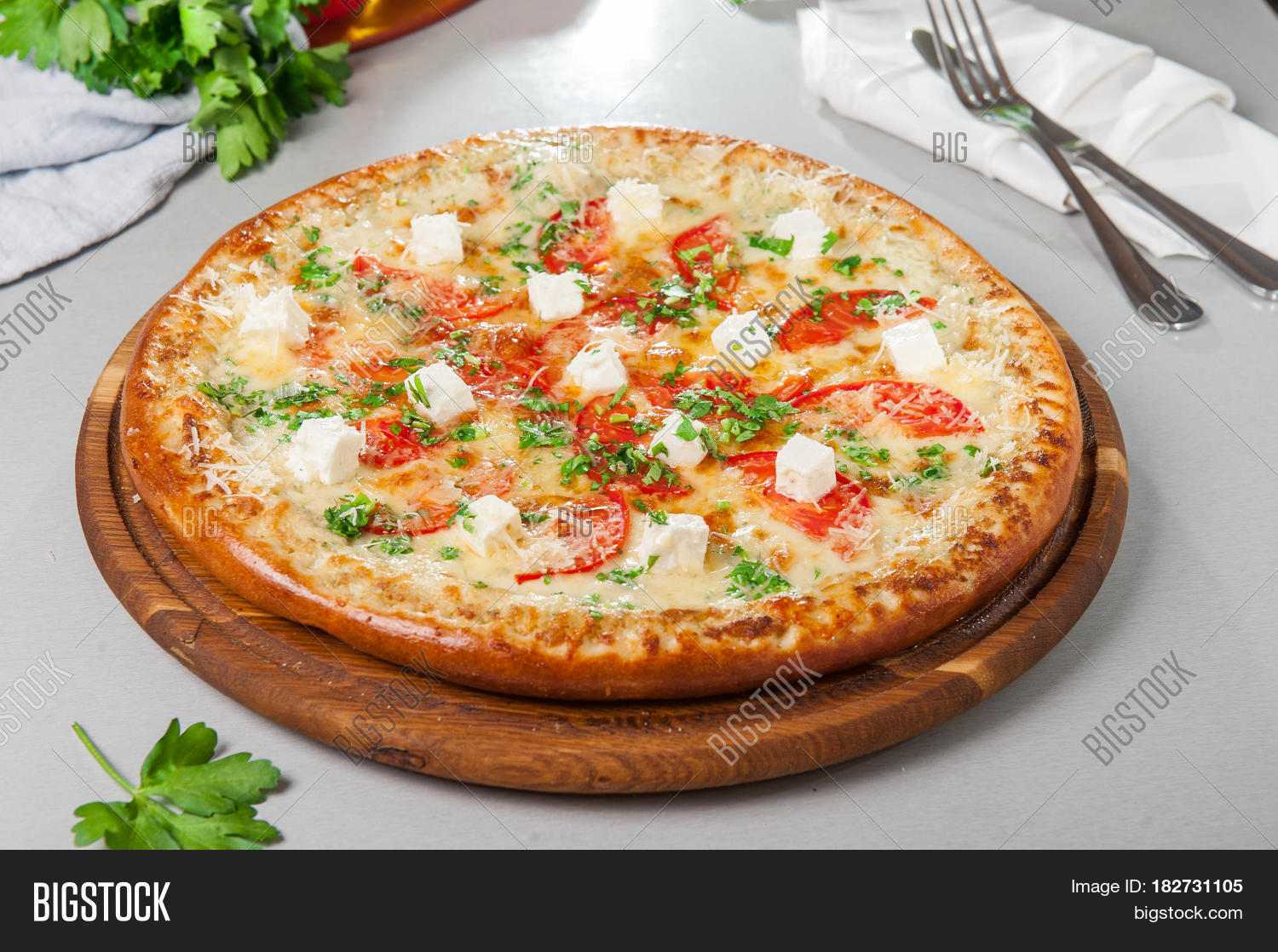 Lovely Four Cheese Pizza Quattro Fromaggi On A Rustic Wooden Board On The Table  With Ingridients.
