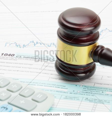 Wooden Judge's Gavel And Calculator Over 1040 Usa Tax Form - Close Up Studio Shot