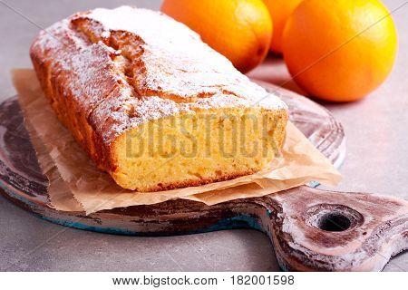 Orange loaf cake sliced on board selective focus