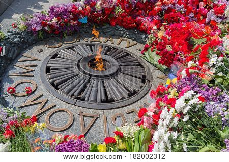 Flowers on Monument with Eternal fire to the unknown soldier. Kiev Ukraine