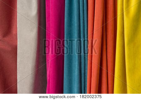 Jaws of colorful fabric in the store