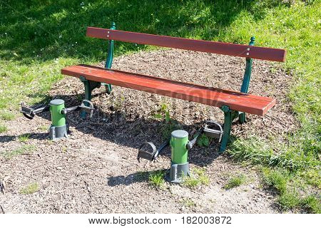 Bench In An Outdoor Park With Pedals For Sports