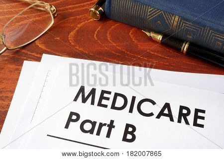 Document with title medicare part bon a table.