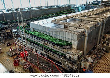 CESKE BUDEJOVICE, CZECH REPUBLIC - JUNE 30, 2016: : Budvar Budweiser brewery. Bottle sorting washing and beer bottling workshop with assembly-lines.
