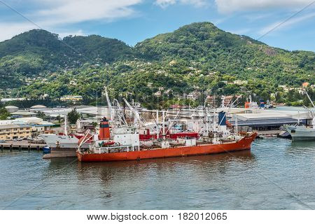 Victoria Mahe island Seychelles - December 17 2015: Reefer ship Retriever in import export and business logistic at the harbor of Port Victoria Mahe island Seychelles Indian Ocean East Africa.