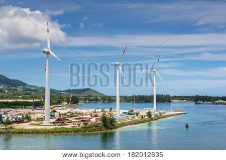 Victoria Mahe island Seychelles - December 17 2015: Wind turbines producing clean electricity in Victoria harbor Mahe Island Seychelles Indian Ocean East Africa.