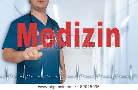 Medizin (in German Medical) Doctor Showing On Viewer With Heart Rate Concept